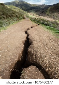 Large erosion crack in landscape from flooding in hills