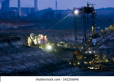 A large excavator digging in a brown-coal mine