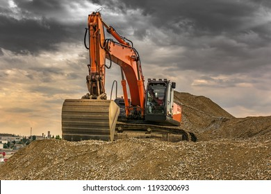 Large excavator moving gravel for the construction works of the road between Madrid and Segovia (Spain)