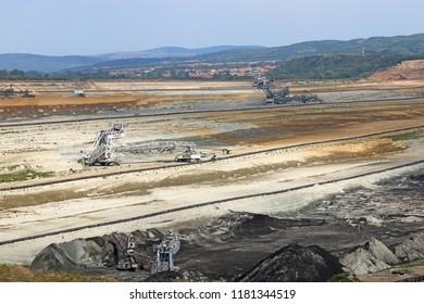large excavators digging coal open pit coal mine