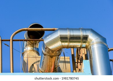 large exhaust pipes into the atmosphere
