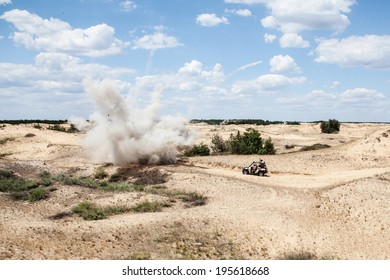 Large explosion near the car with soldiers in the desert