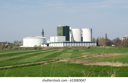Large factory with a silo and two towers
