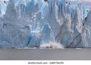 Large falling chunk of ice from Perito Moreno glacier in Los Glaciares National Park, Santa Cruz province, Argentina