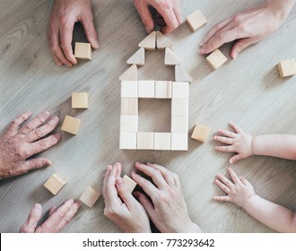 a large family is building a house. concept for loan and construction