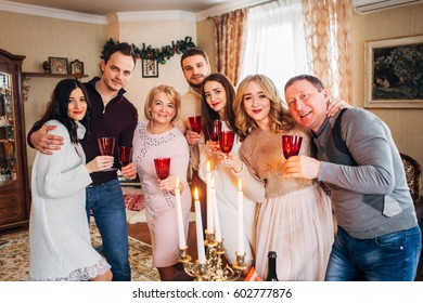 large family celebrates Christmas and drinking champagne