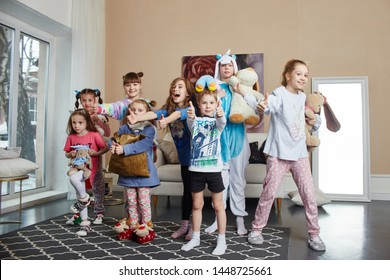 Large family, children have fun and play in the morning at home. Boys and girls in night pajamas, a friendly big family. Russia, Sverdlovsk, 10 March 2019
