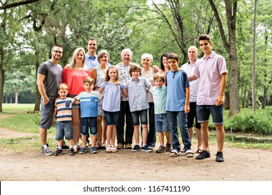 Large family with cousin grandparent father and kid on a forest