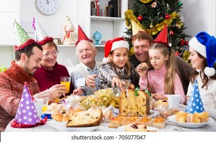 Large family enjoying festive meal during Christmas dinner at home