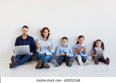 Large family with gadgets