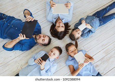 Large family with gadgets. Parents and children at laptops