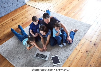 large family at home watching a movie