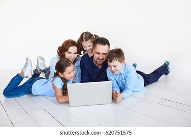 large family at home watching a movie. happy family at home looking at laptop.