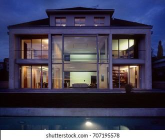large family house with swimming pool at the night