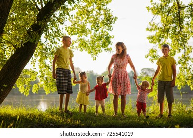 A large family on a walk, a mother with five children