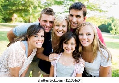 large family outside together smiling