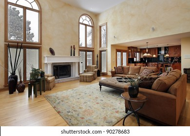 Large family room with two story curved windows