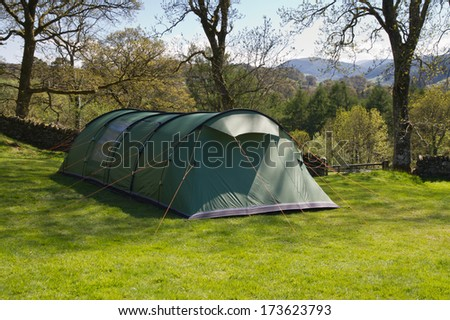 Large family tunnel tent in a shady spot . & Large Family Tunnel Tent Shady Spot Stock Photo (Edit Now) 173623793 ...