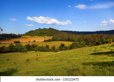 Large farm property against a blue sky