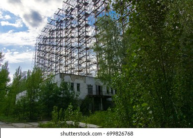 Large field of the looted antenna of the military object of the PRO of the USSR. Dead military unit. Consequences of the Chernobyl disaster, August 2017.