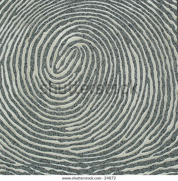 A large fingerprint carved into a slab of granite