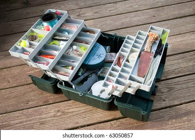 A large fisherman's tackle box fully stocked with lures and gear for fishing.