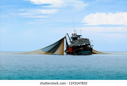 Large fishing trawlers are fishing in the sea.