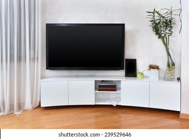Large flat screen TV in modern interior living room