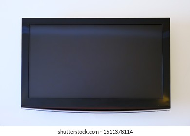 Large flat screen TV on white wall, mock-up