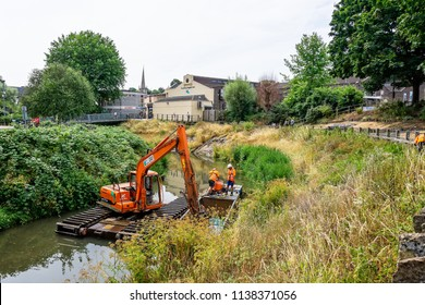 Large floating crane dredging river taken in Frome, Somerset, UK on 19 July 2018