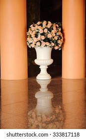 large flower vase and reflect on the floor