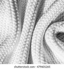 large folds on the warm knit light scarf, monochrome