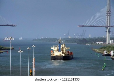 Large freighter approaching  construction of new French cantilevered bridge Panama Canal