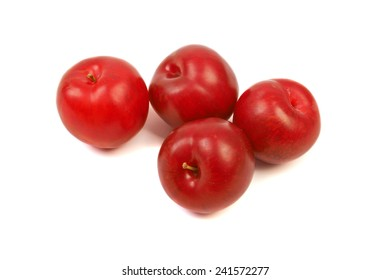Large fresh ripe plums nectarines, healthy ingredient isolated on white background.