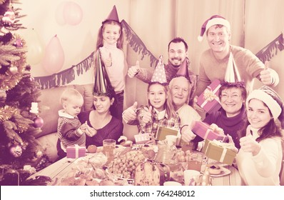 Large friendly family happy to see each other during the Christmas dinner