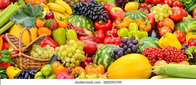 Large fruit colorful background of fresh vegetables and fruits.
