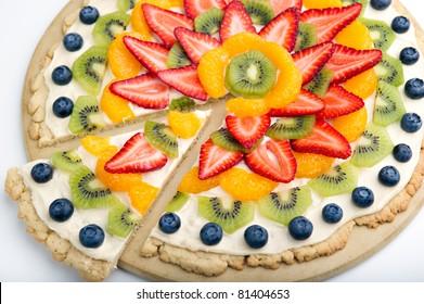 Large fruit tart with strawberry, kiwi, blueberry, oranges