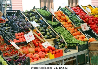 large fruit and vegetable stand with seasonal fruits in the local market of the city