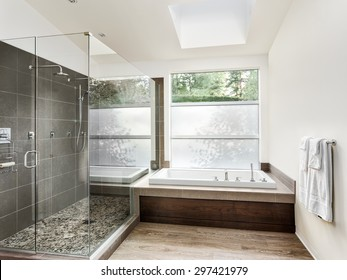 Large furnished bathroom in luxury home with hardwood floor, shower, and bathtub