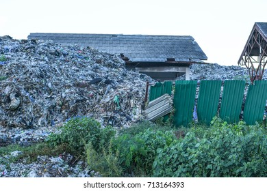 A large garbage pile consisting of plastic bag scrap. That comes from the households of the urban community. In developing countries South East Asia