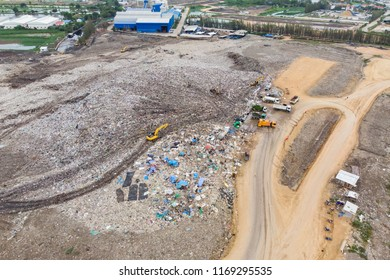 Large garbage pile, degraded garbage. Pile of stink and toxic residue / Garbage pile in trash dump or landfill - Recycling industry, Bird's-eye view from drone