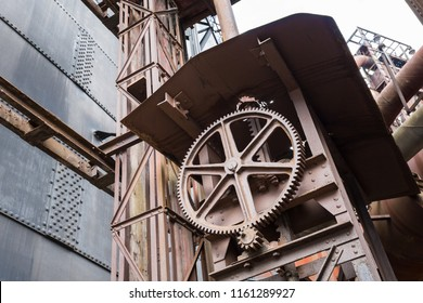A large gear wheel on a small one in an abandoned steel factory named Vitkovice in Ostrava, Czech Republic