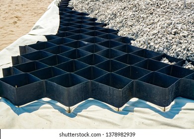 large geogrid at the base of the new road, road construction, reinforcement