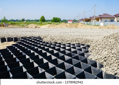 large geogrid at the base of the new road, road construction, reinforcement, covered with gravel