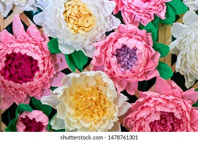 Large Giant Paper Flowers. Big pink, white, beige peons. Pastel floral background pattern lovely style. Flower made from corrugated paper and EVA Foam Paper
