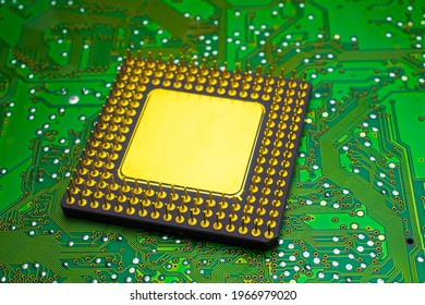 large gilded ceramic processor. intel pentium pro. gold recovery and recycling in green PCB