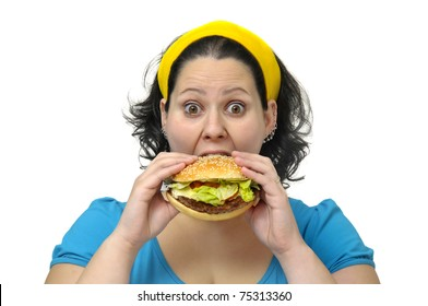Large girl eating a hamburger isolated in white