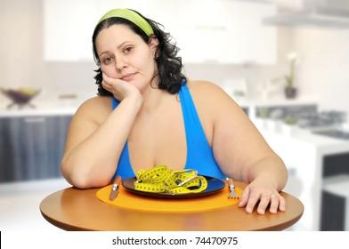 Large girl eating a measuring tape