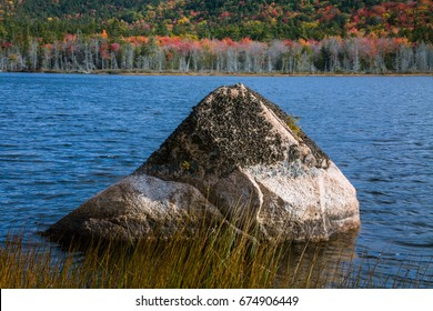 A Large Glacial Erratic Boulder Sits In Seal Cove Pond On A Beautiful Autumn Afternoon, Mount Desert Island, Acadia National Park, Maine, USA