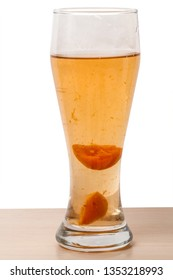 A large glass of cold apricot compote